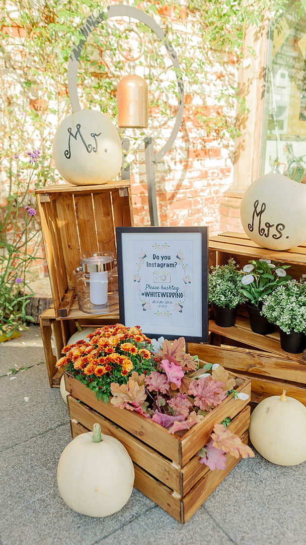 Wooden boxes and white pumpkins are perfect for a rustic autumn themed wedding at Gaynes Park