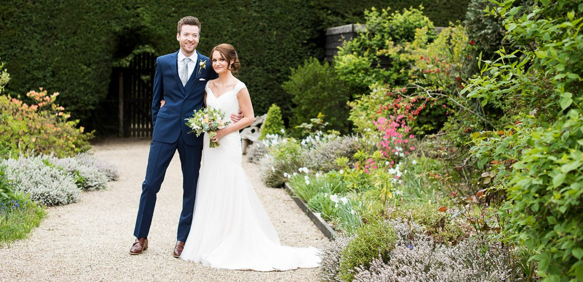 Bride and groom enjoying the Walled Gardens at Gaynes Park wedding venue in Essex
