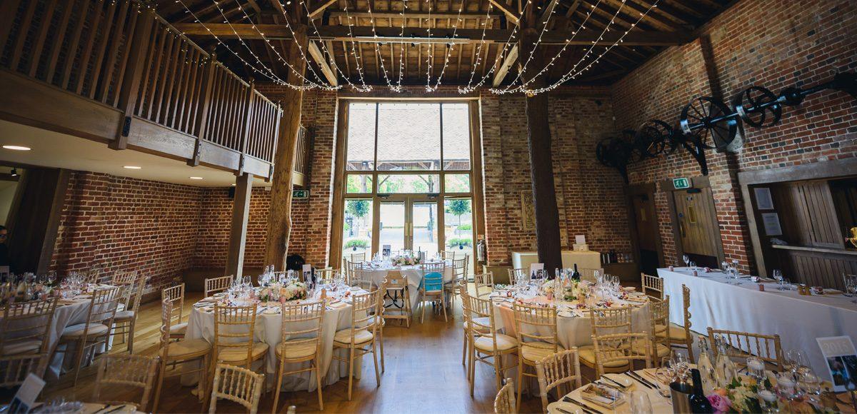 Gaynes Park wedding breakfast set up inside the Mill Barn