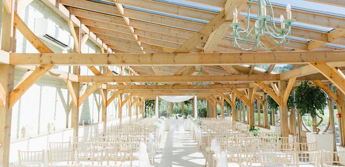 A ceremony set up inside the Orangery at Gaynes Park – Essex wedding venues