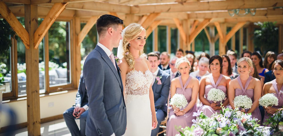 Bride and groom in the Orangery at Gaynes Park