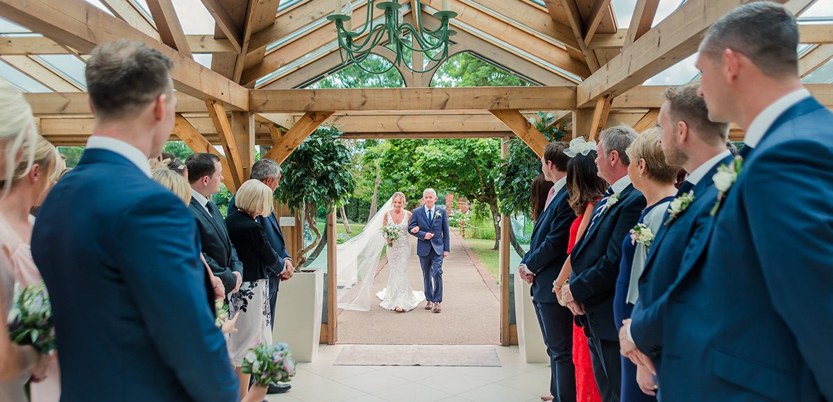Bride arriving in the Orangery with her father