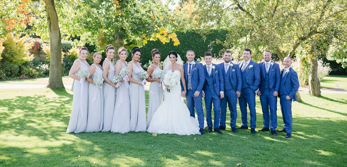 The bridal party in the beautiful gardens at Gaynes Park, Essex