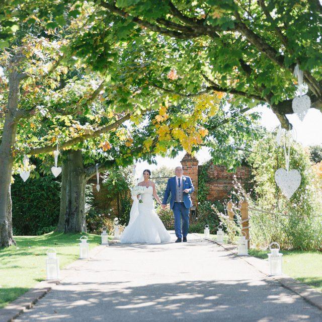 Bride and Groom enjoying the gardens at Gaynes Park, Essex