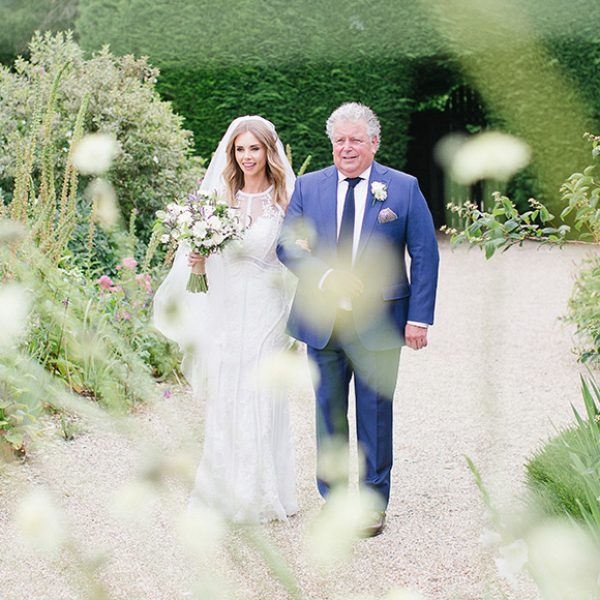 Bride walking down the aisle with her father at Gaynes Park
