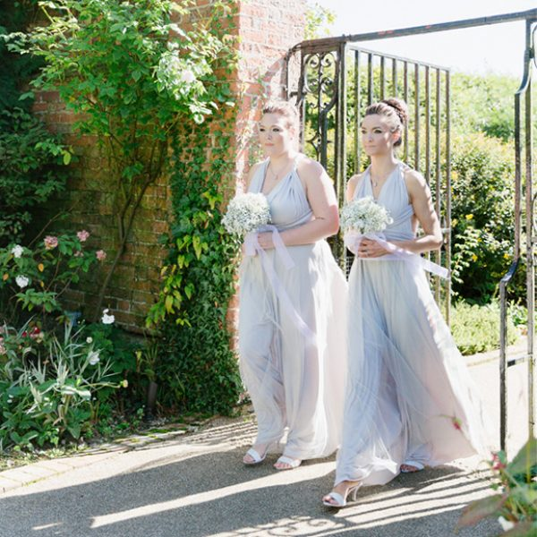 Bridesmaids in the beautiful gardens wearing lilac dresses