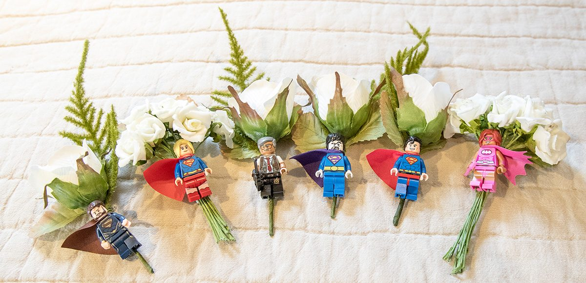A close up of the buttonholes which were a single white flower and a Lego man