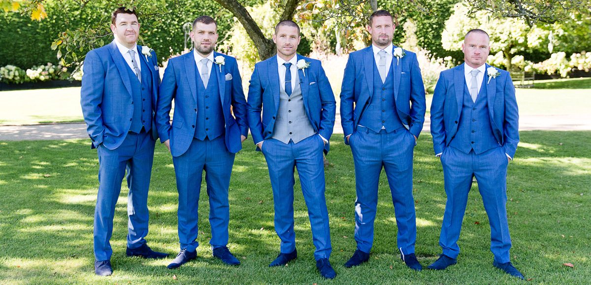 Groom and his groomsmen in blue suits