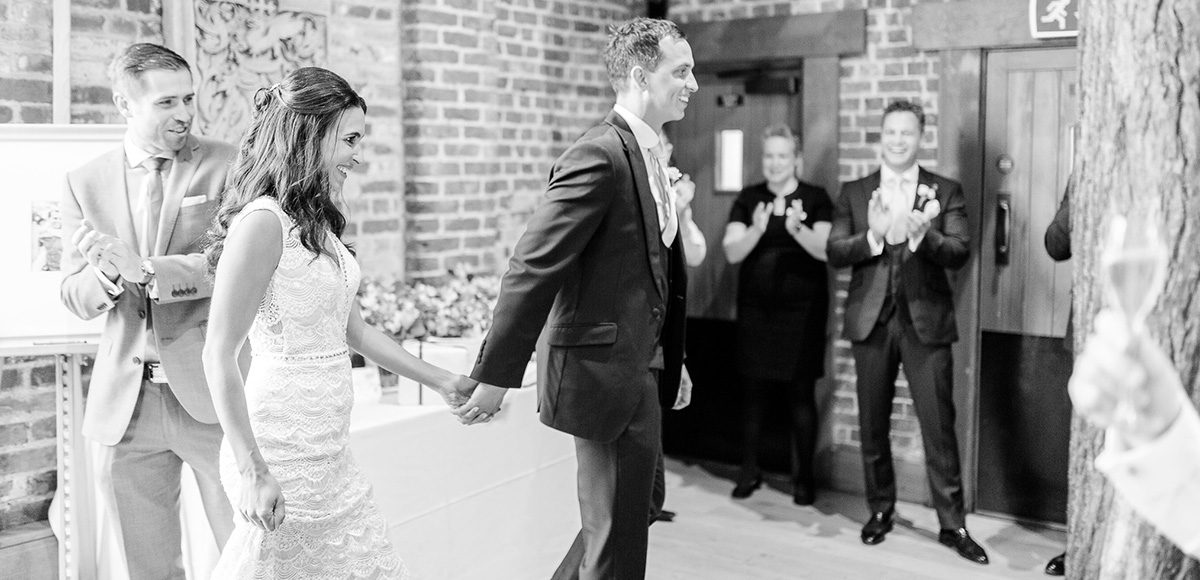 Newlyweds entering the Mill Barn in Gaynes Park