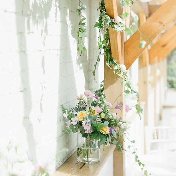 The Orangery is decorated with ivy which drapes around the oak beams of this gorgeous wedding ceremony venue