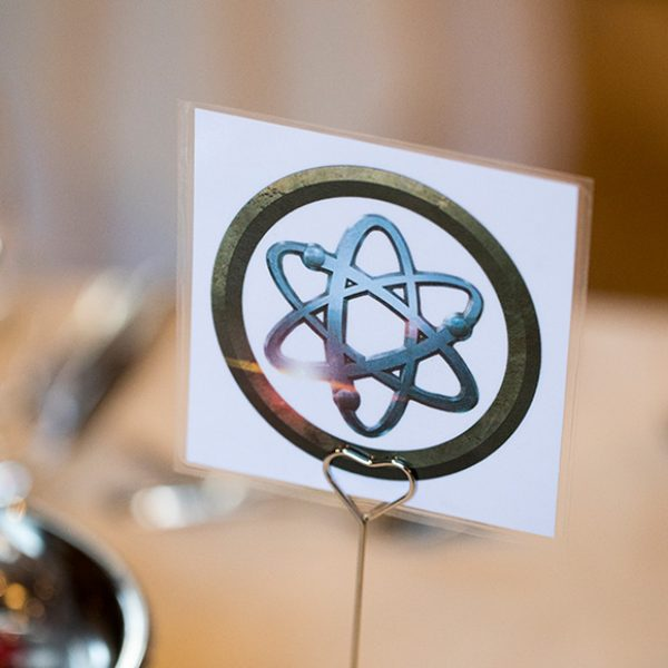 Superhero emblems inspired the couple's wedding table names – wedding ideas