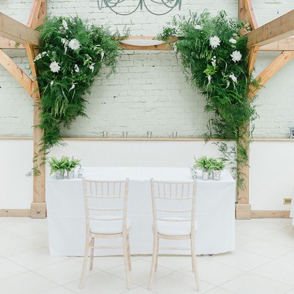 White flowers laid out in the Orangery at Gaynes Park