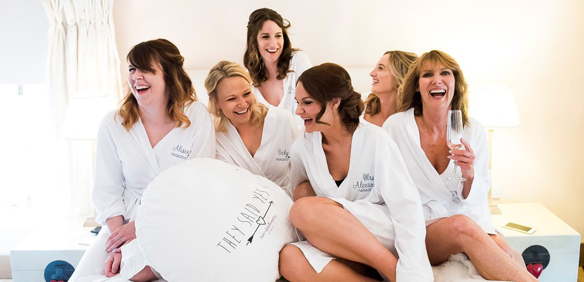The bride and her bridesmaids enjoy wedding preparations in the Coach House at Gaynes Park