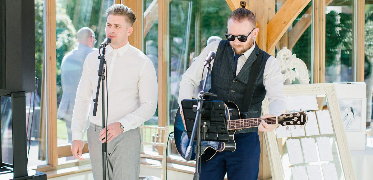 A wedding band entertain guests during the drinks reception in the Orangery at Gaynes Park in Essex