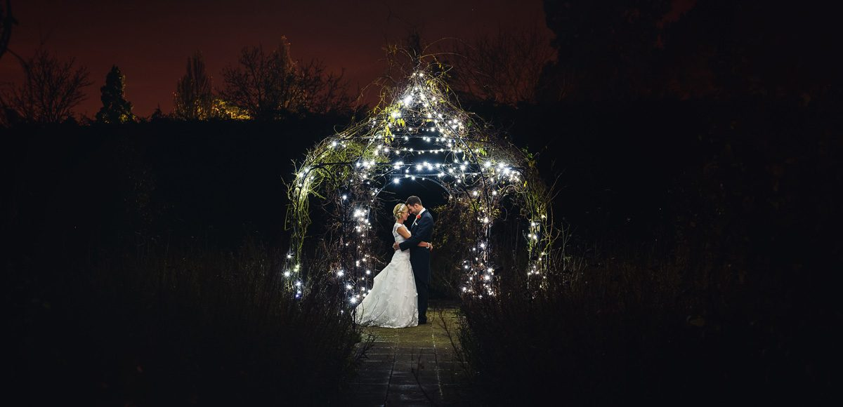 The new husband and wife gather under the stunning pavilion for a gorgeous wedding photo at Gaynes Park in Essex