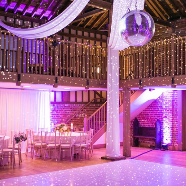 The Mill Barn at Gaynes Park in Essex looks stunning with a giant glitter ball and is perfect for your evening reception