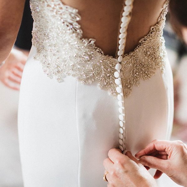 A bridal gown is adorned with gold and silver crystals for a vintage wedding look