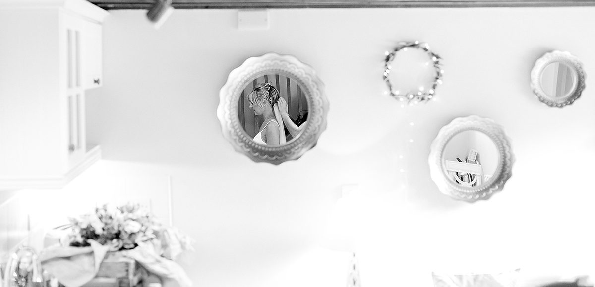 Final bridal preparations are made in the Appleloft Cottage at Gaynes Park in Essex