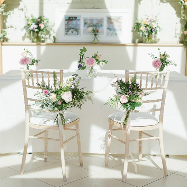 For the wedding ceremony at Gaynes Park the Orangery was decorated with spring wedding flowers
