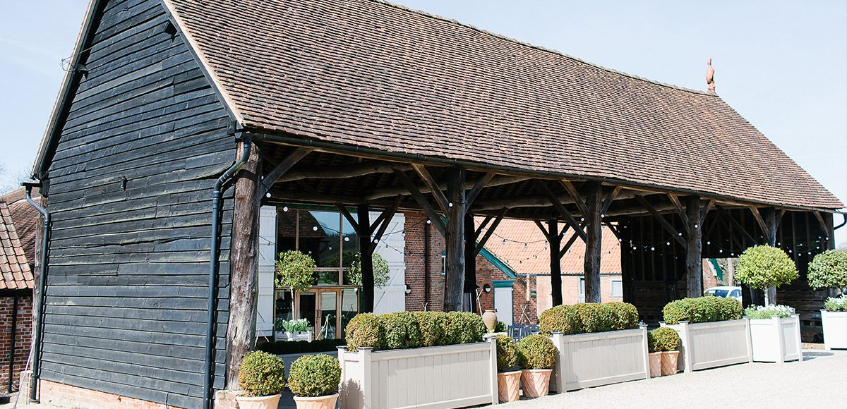 The Gather Barn at Gaynes Park in Essex is a fantastic covered outside space for your wedding guests to enjoy