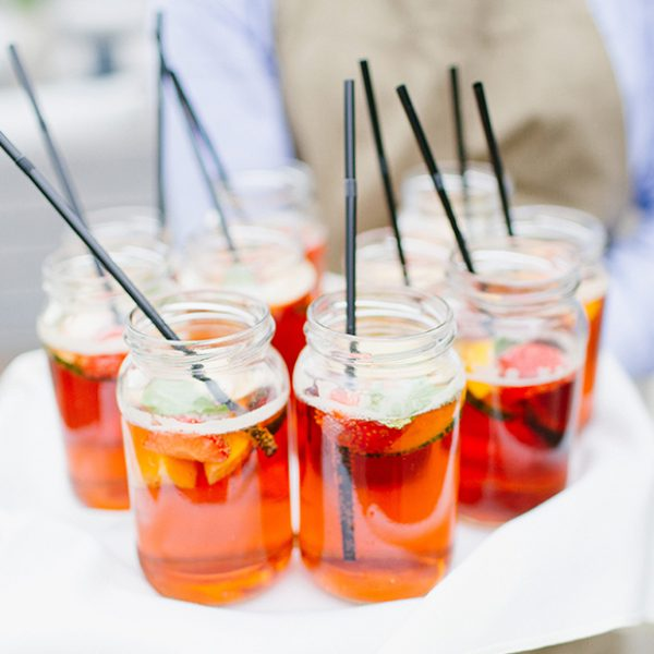 Jam jars filled with Pimms were served to wedding guests during the wedding reception at Gaynes Park