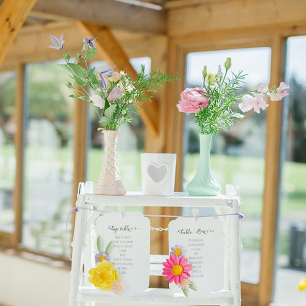 A rustic ladder was decorated with spring wedding flowers to create a cheerful table plan – wedding ideas