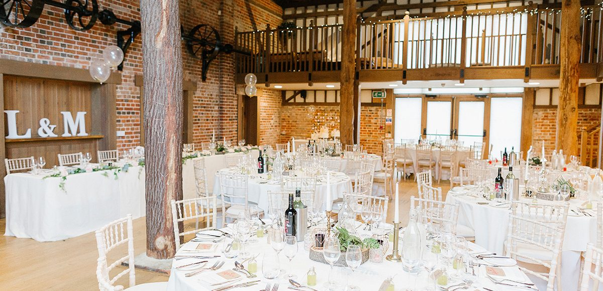 The Mill Barn at Gaynes Park looked elegant decorated with geometric candle holders and planters