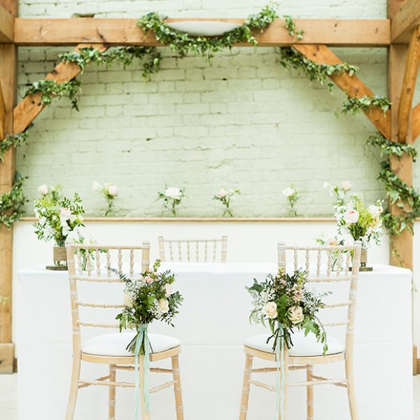 The Orangery at Gaynes Park is decorated in wedding flowers for a wedding ceremony