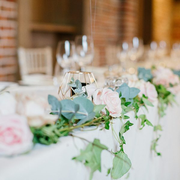 The couple decorated the Essex wedding venue with geometric candle holders and pink roses for their wedding reception