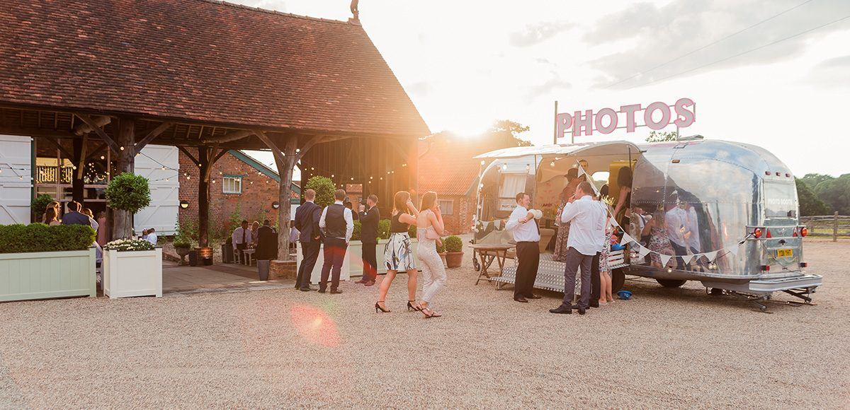 An airstream caravan creates the perfect wedding photobooth for a wedding at Gaynes Park