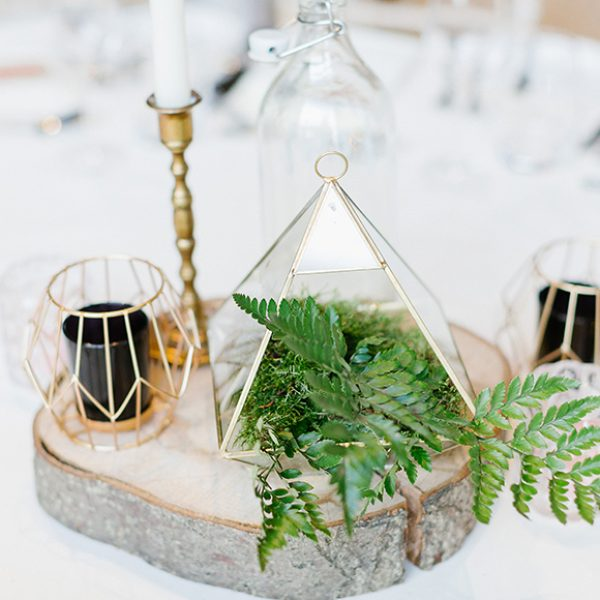 Geometric candle holders and planters made perfect wedding table centrepieces for the wedding reception at Gaynes Park