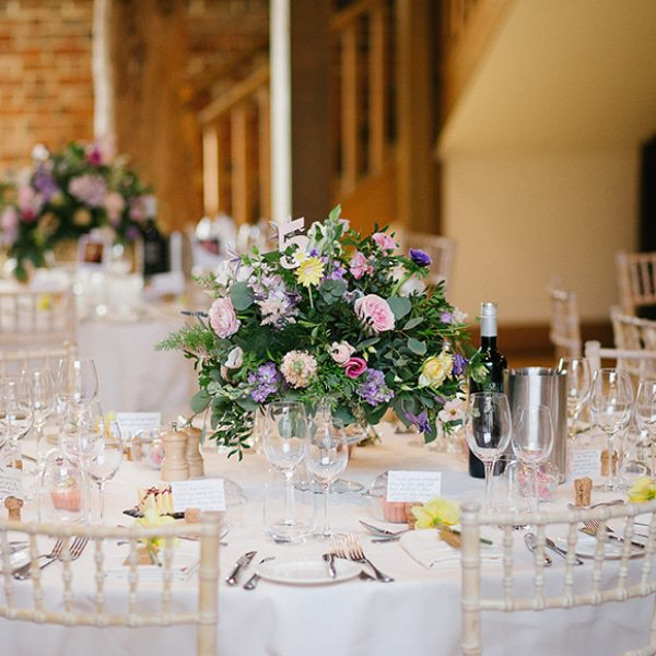 Tables in the Mill Barn at Gaynes Park were decorated with spring floral centerpieces