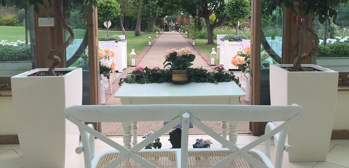 Looking out of the Orangery down the wedding aisle at Gaynes Park
