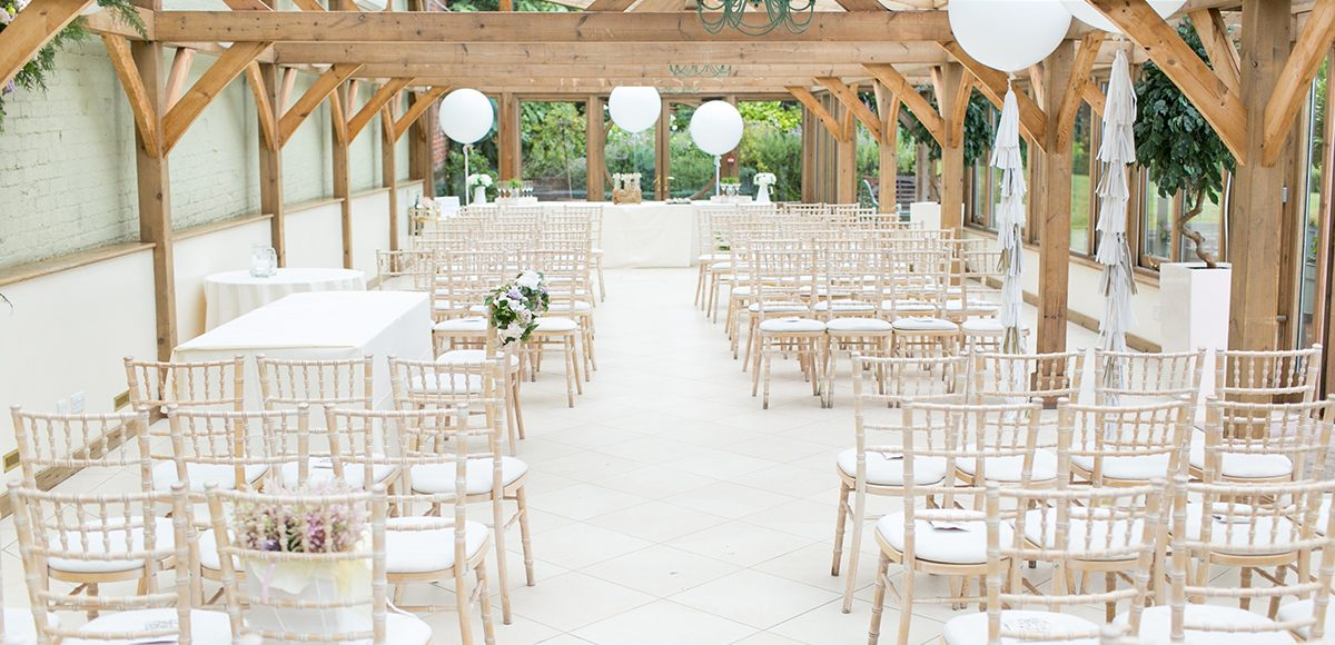 The Orangery at the Gaynes Park wedding venue in Essex is set up for a beautiful wedding ceremony