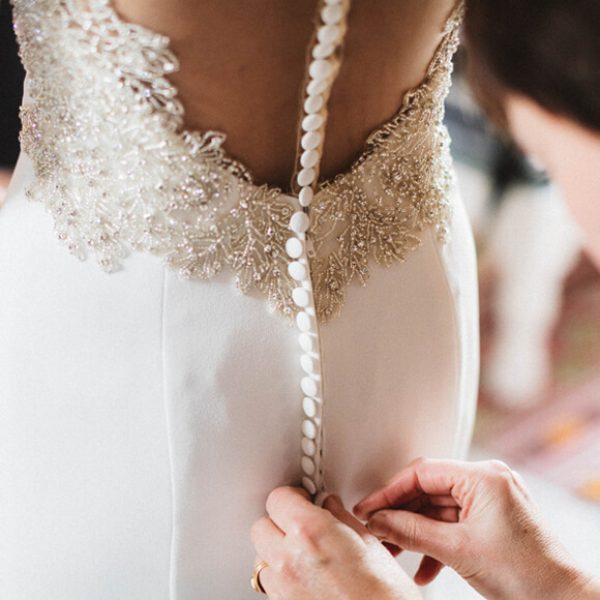 The back of the bridal gown worn by one of the brides at Gaynes Park had stunning button details