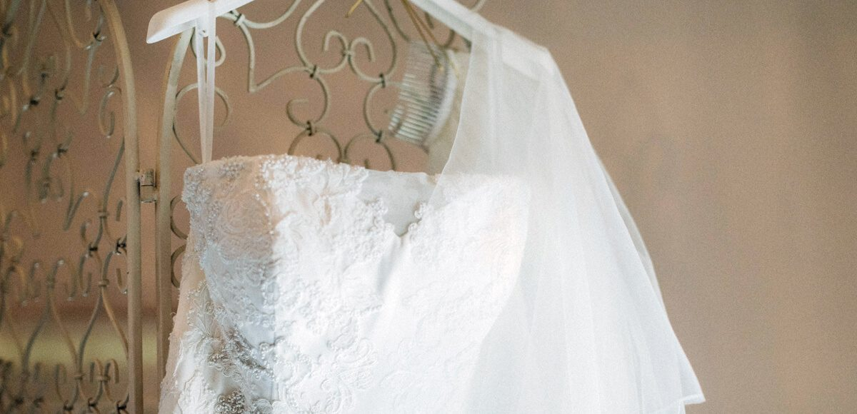 One of the brides wore a stunning white bridal gown with delicate lace detail for her wedding at Gaynes Park