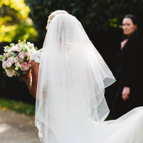 A bride wears a two tiered bridal veil for her wedding day at Gaynes Park wedding venue in Essex