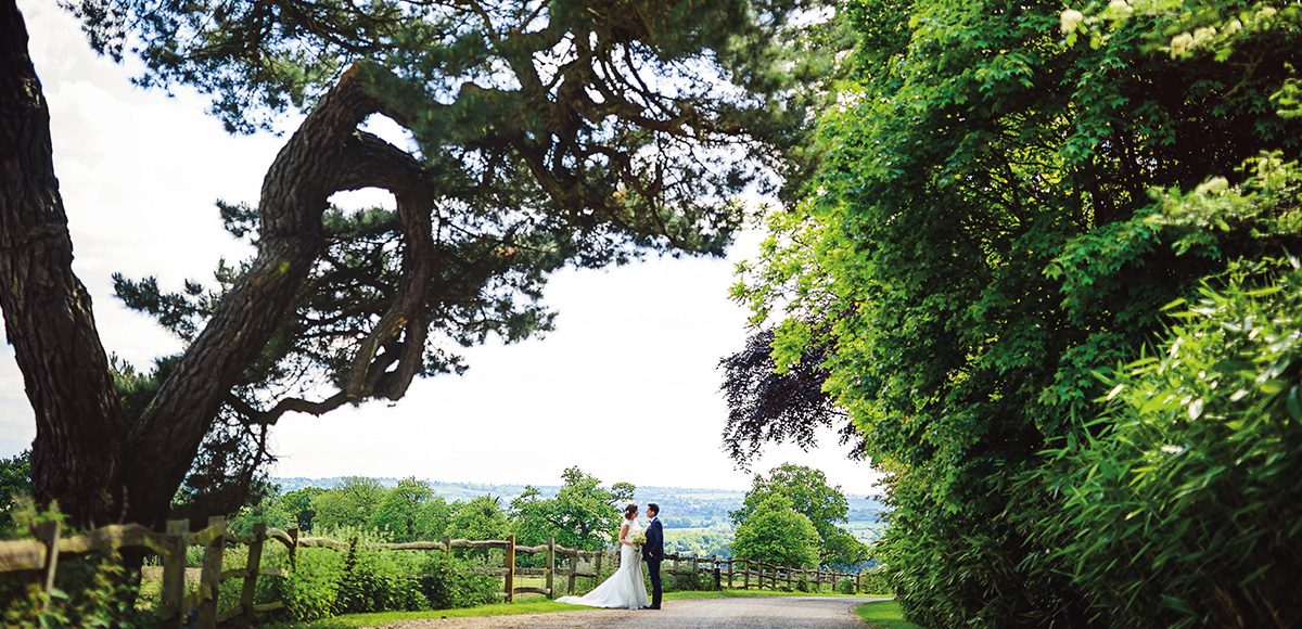 Newlyweds explore the stunning Essex countryside that surrounds Gaynes Park wedding venue