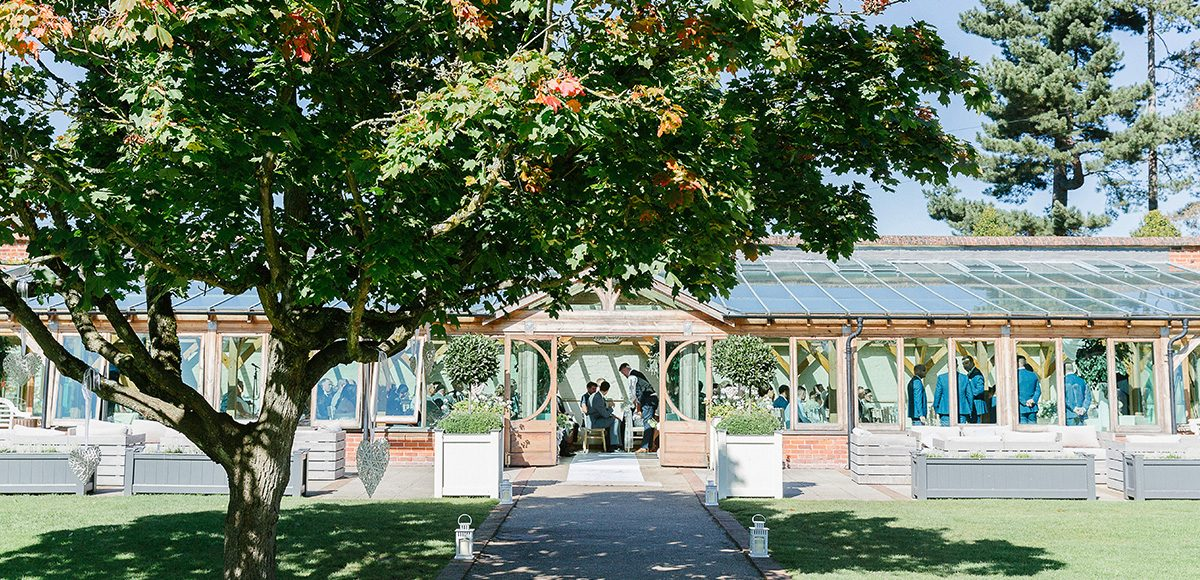 A stunning wedding ceremony takes place in the Orangery at Gaynes Park in Essex