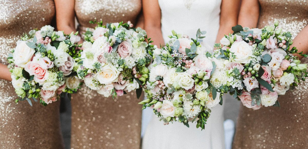 The couple chose a pink and gold wedding theme which included pink wedding flowers and gold bridesmaid dresses