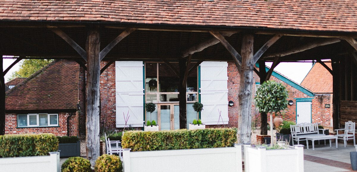 The Gather Barn at Gaynes Park is an ideal covered outdoor space for an autumn wedding