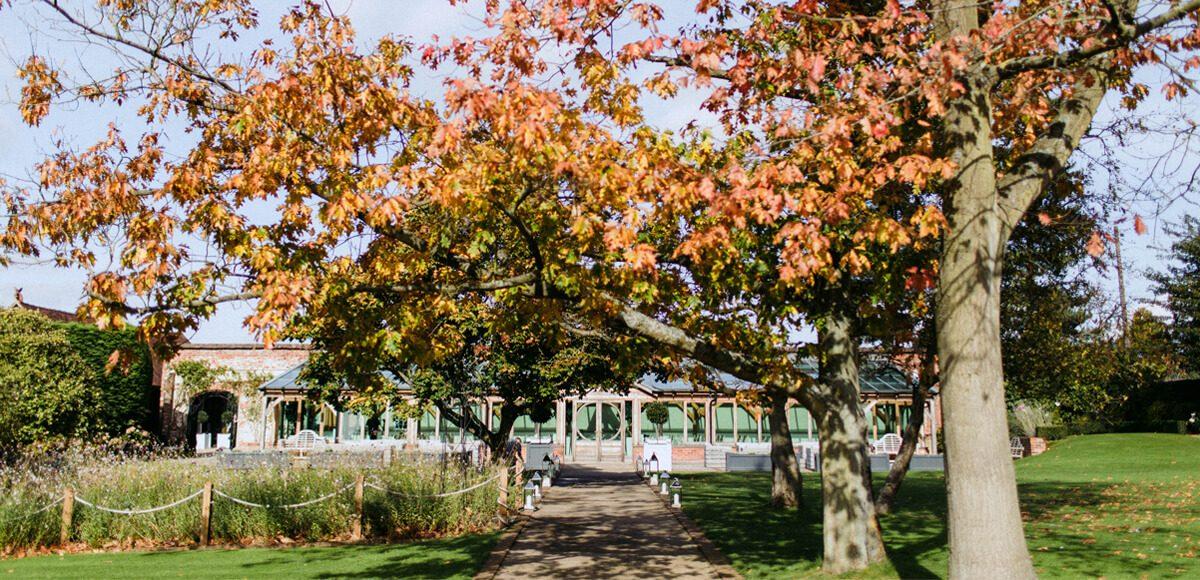 The Orangery at Gaynes Park wedding venue in Essex looks stunning in the autumn sun