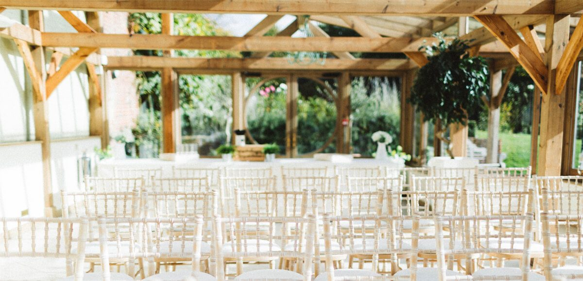 The Orangery at Gaynes Park in Essex is set up for a beautiful autumn wedding ceremony