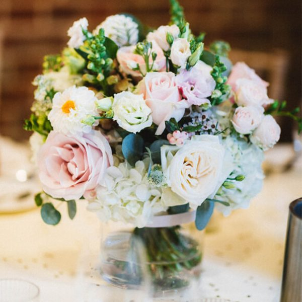 For their wedding at Gaynes Park in Essex the couple chose classic pink and white roses for their wedding flowers