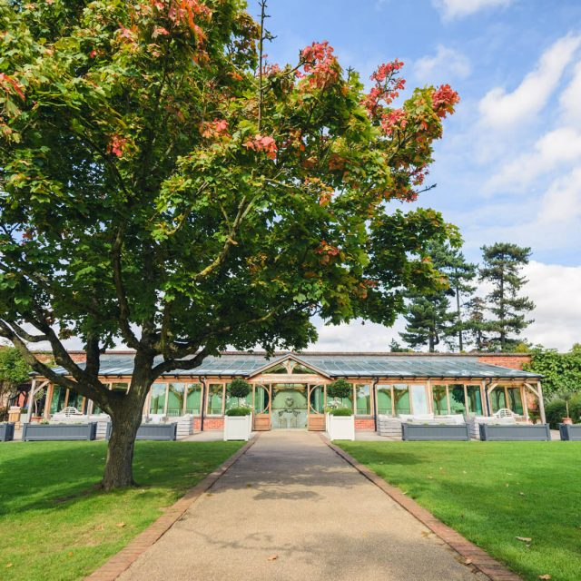 The Orangery at Gaynes Park wedding venue in Essex sits within stunning walled gardens