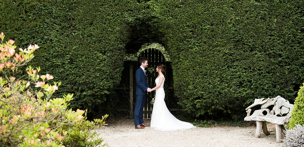 The bride and groom enjoy a moment on the beautiful Long Walk at Gaynes Park wedding venue in Essex