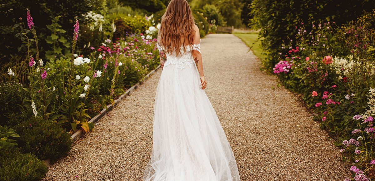 The bride wore an intricate boho style lace wedding dress for her wedding day at Gaynes Park in Essex