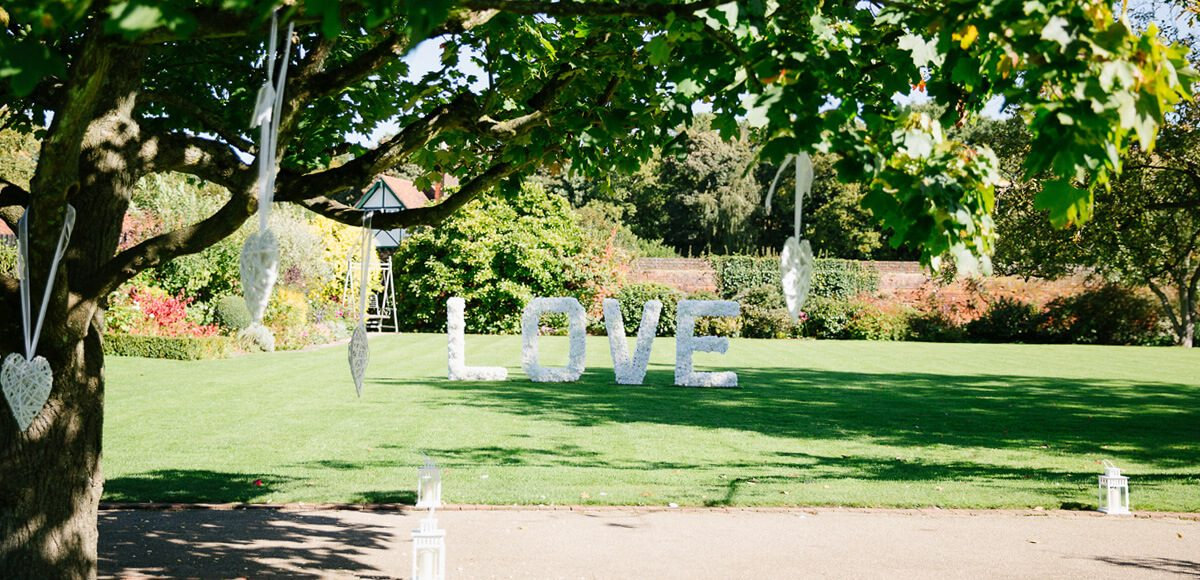Large love letters are placed on the lawns in the Walled Gardens at Gaynes Park for a fantastic