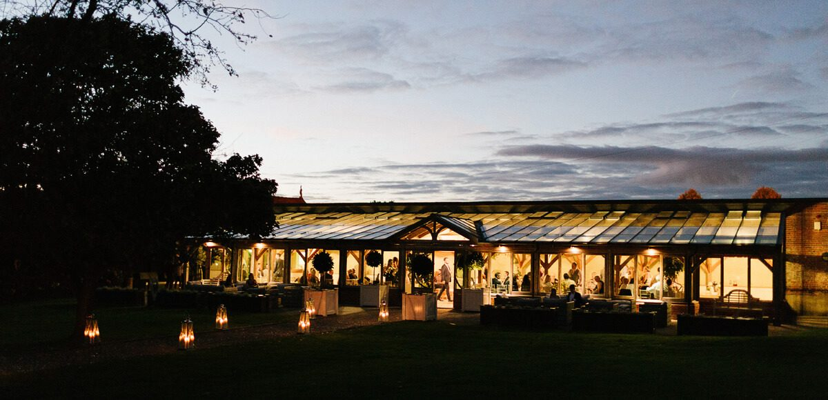 The Orangery looks beautiful as the sun sets over Gaynes Park wedding venue in Essex