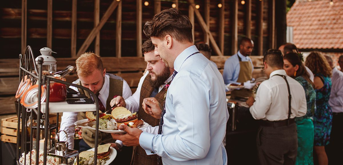 Guests help themselves to relaxed wedding food at Gaynes Park in Essex